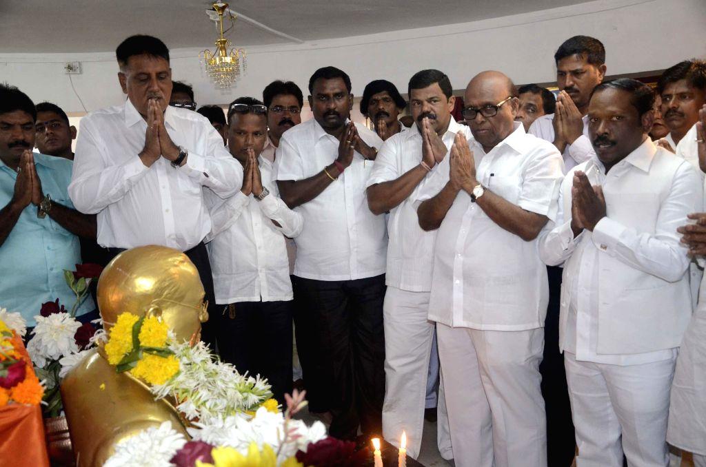 Congress leader Eknath Gaikwad pay tribute to Dr. BR Ambedkar on his birth anniversary at Chaitya Bhoomi in Mumbai on April 14, 2014.