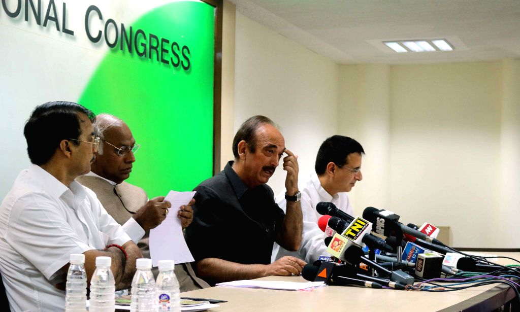 Congress leader Ghulam Nabi Azad, Mallikarjun Kharge and Randeep Surjewala during a press conference in New Delhi, on Aug 14, 2015.