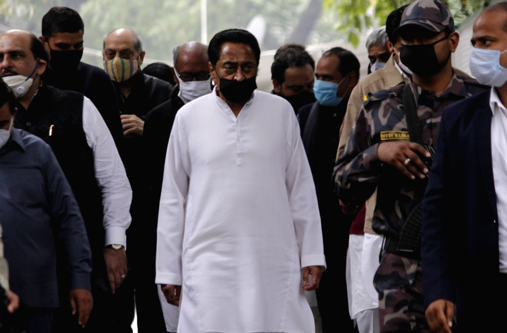Congress leader Kamal Nath arrives to pay tributes party veteran to Ahmed Patel who passed away at 3.30 am in a Gurugram hospital following Covid-19 complications, in New Delhi on Nov 25, ... - Kamal Nath and Ahmed Patel