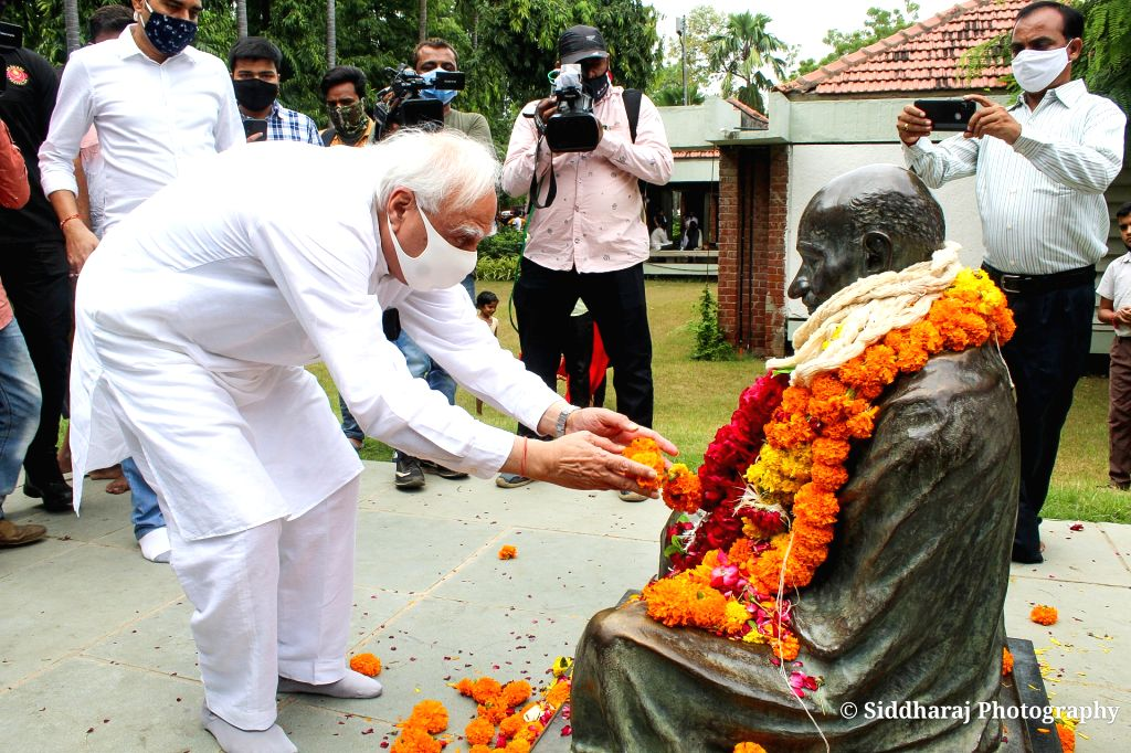 Congress leader Kapil Sibbal offers tribute to Mahatma Gandhi on the occasion of his Birth Anniversary at Gandhi Ashram in Ahmedabad on Saturday October 02,2021