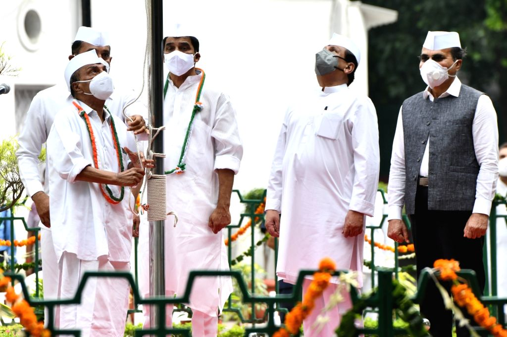 Congress leader KC Venugopal accompanied by other leaders of the party, hoists the national flag during the 74th Independence Day celebrations at the party headquarters in New Delhi on Aug ...