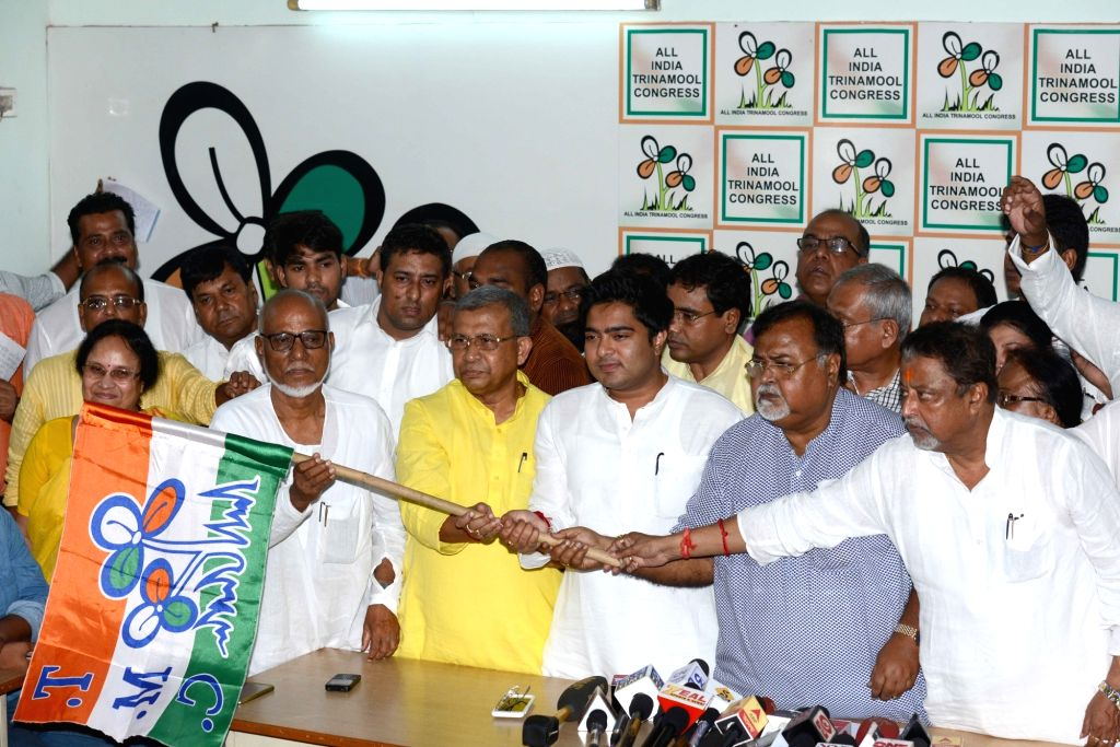 Congress leader Manas Bhunia joins Trinamool Congress in presence of party leaders Mukul Roy and Partha Chatterjee in Kolkata on Sept 19, 2016. - Mukul Roy and Partha Chatterjee