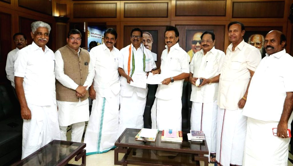 Congress leader Mukul Wasik and Dravida Munnetra Kazhagam (DMK) chief MK Stalin finalize an agreement to jointly contest the Lok Sabha elections in Tamil Nadu and Puducherry; in Chennai, on ...