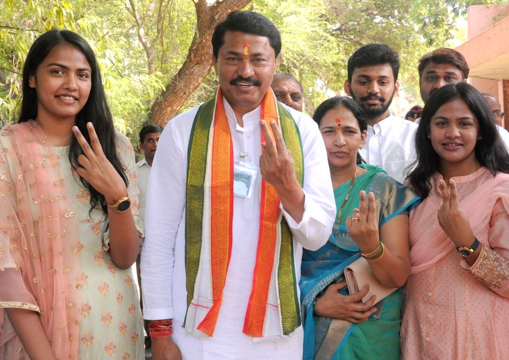 Congress leader Nana Patole shows his inked finger after casting vote for Lok Sabha election, at a polling station, in Nagpur, on April 11, 2019.