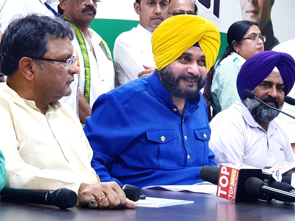 Congress leader Navjot Singh Sidhu addresses a press conference in Raipur, on April 11, 2019. - Navjot Singh Sidhu