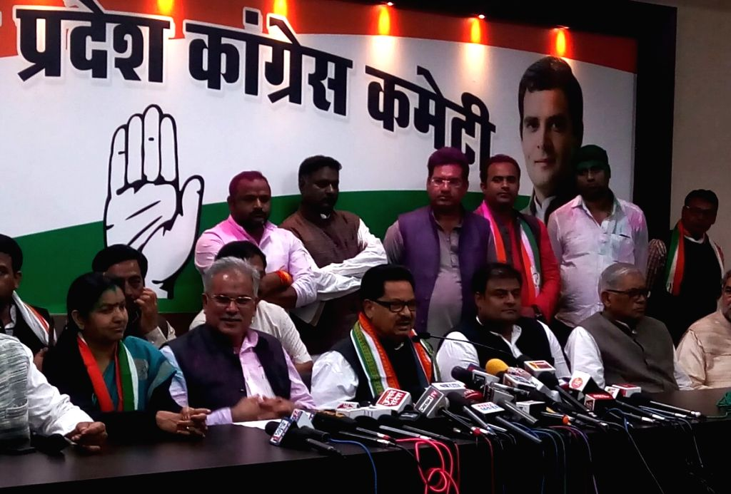 Congress leader P.L. Punia accompanied by Chhattisgarh Congress president Bhupesh Baghel and other leaders of the the party, addresses a press conference after the party swept Chhattisgarh ...