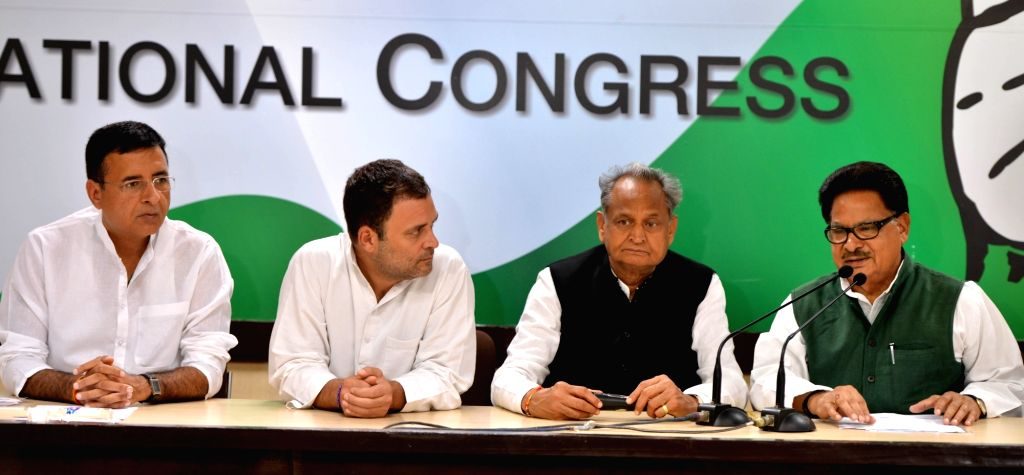 Congress leader P. L. Punia addresses a press conference along with party president Rahul Gandhi and party leaders Randeep Surjewala and Ashok Gehlot, in New Delhi on Sept 13, 2018. - Rahul Gandhi
