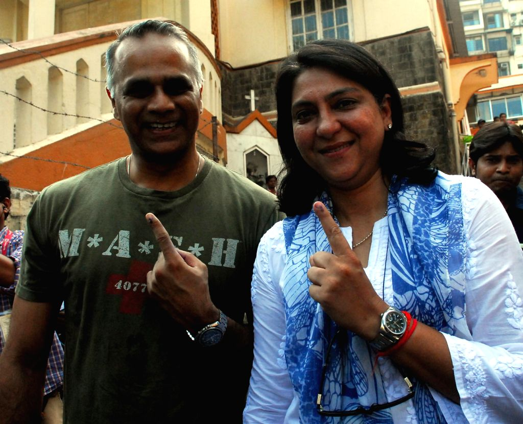 Congress leader Priya Dutt shows her fore finger marked with phosphorous ink after casting her vote at a polling booth during the sixth phase of 2014 Lok Sabha Polls in Mumbai on April 24, 2014.