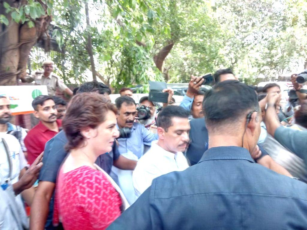 Congress leader Priyanka Gandhi Vadra along with her husband Robert Vadra arrives to cast her vote at the polling booth setup in Sardar Patel Vidyalaya at Lodhi Estate, New Delhi on May ... - Priyanka Gandhi Vadra and Sardar Patel Vidyalaya