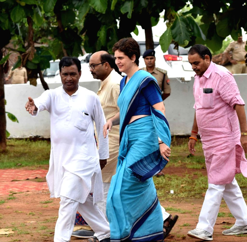 Congress leader Priyanka Gandhi Vadra meets the family members of the victims who were killed in the July 17 massacre over a land dispute in Umbha village in UP's Sonebhadra district on ... - Priyanka Gandhi Vadra