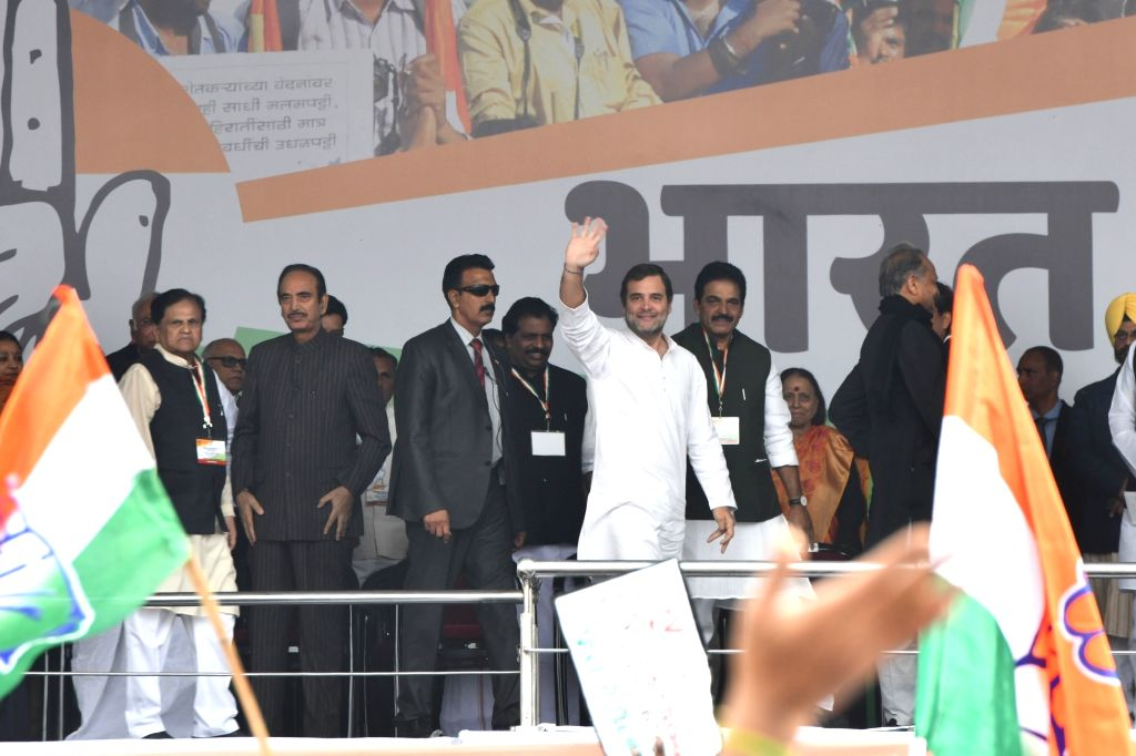 Congress leader Rahul Gandhi waves at party workers during 'Bharat Bachao' Rally organised by the party 'against the dictatorship of the BJP government and slaughtering of Indian economy ... - Ashok Gehlot, Rahul Gandhi and Ahmed Patel