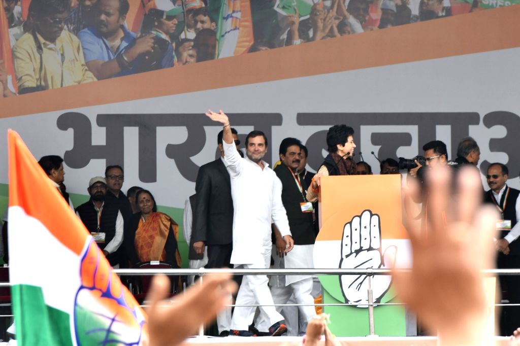 Congress leader Rahul Gandhi waves at party workers during 'Bharat Bachao' Rally organised by the party 'against the dictatorship of the BJP government and slaughtering of Indian economy ... - Rahul Gandhi