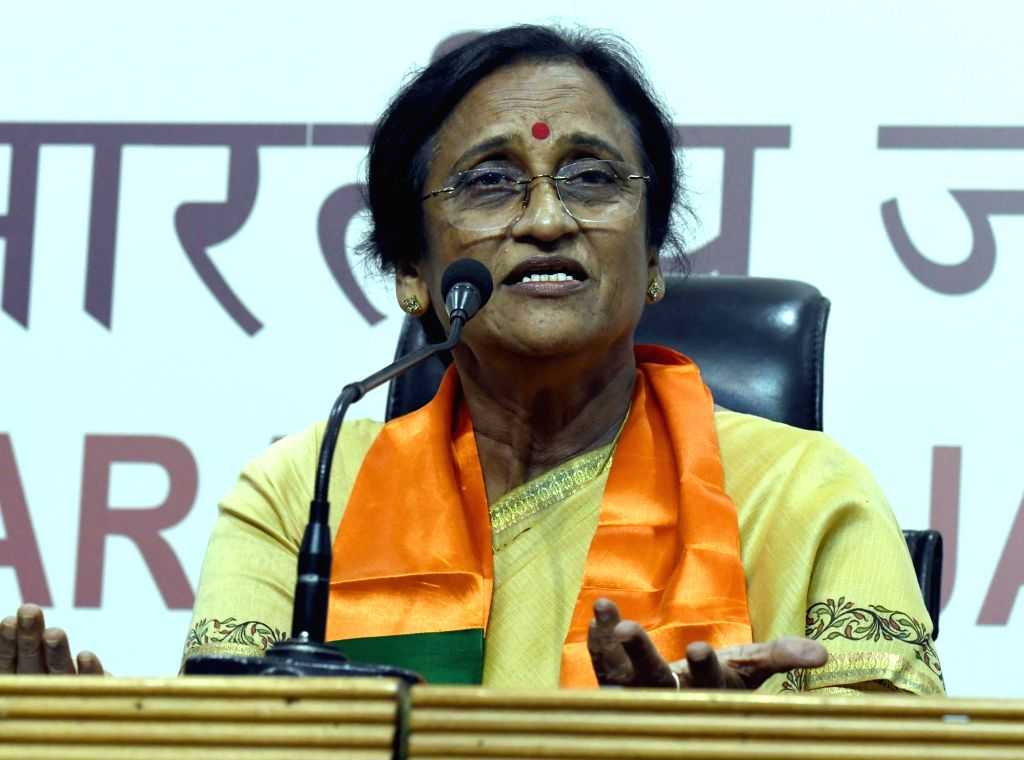 Congress leader Rita Bahuguna Joshi addresses a press conference after joining BJP in presence of BJP chief Amit Shah in New Delhi, on Oct 20, 2016. - Rita Bahuguna Joshi and Amit Shah