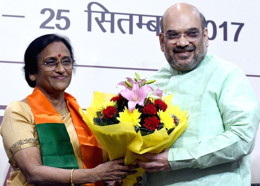 Congress leader Rita Bahuguna Joshi joins BJP in presence of BJP chief Amit Shah in New Delhi, on Oct 20, 2016. - Rita Bahuguna Joshi and Amit Shah