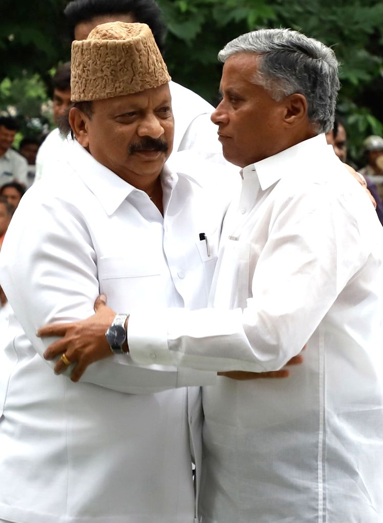Congress leader Roshan Baig and BJP MLA V Somanna during B. S. Yediyurappa's swearing-in ceremony at Raj Bhavan in Bengaluru on July 26, 2019.