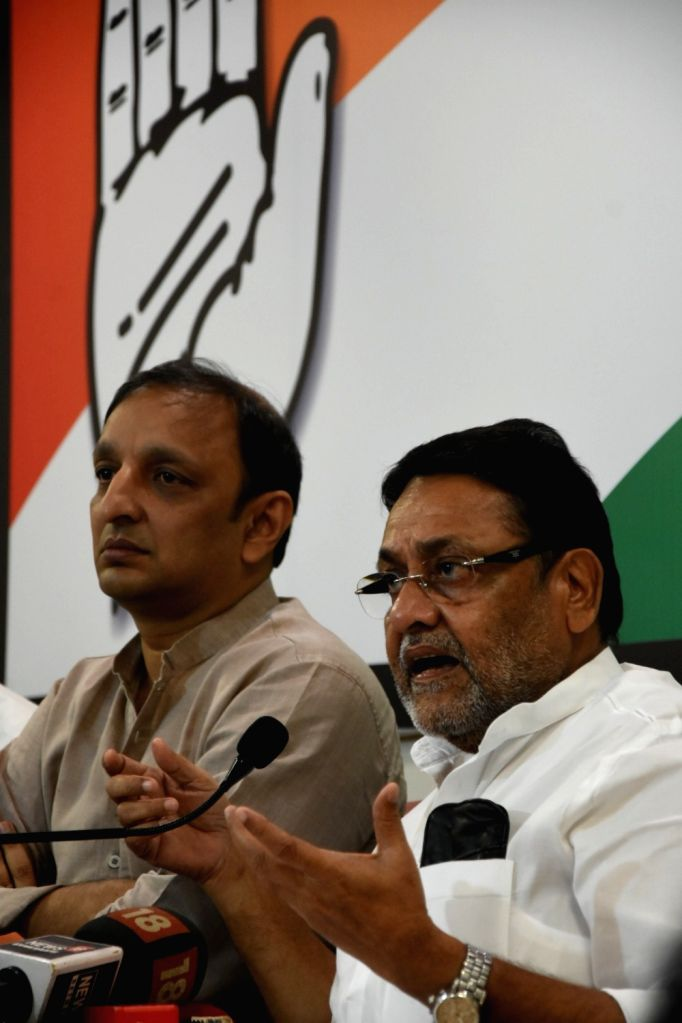 Congress leader Sachin Sawant accompanied by Nationalist Congress Party (NCP) leader Nawab Malik, addresses during a joint press conference in Mumbai on Sep 24, 2019. - Malik