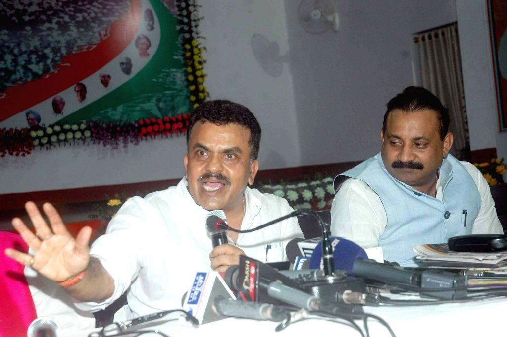 Congress leader Sanjay Nirupam addresses a press conference in Patna 0n May 26, 2016.