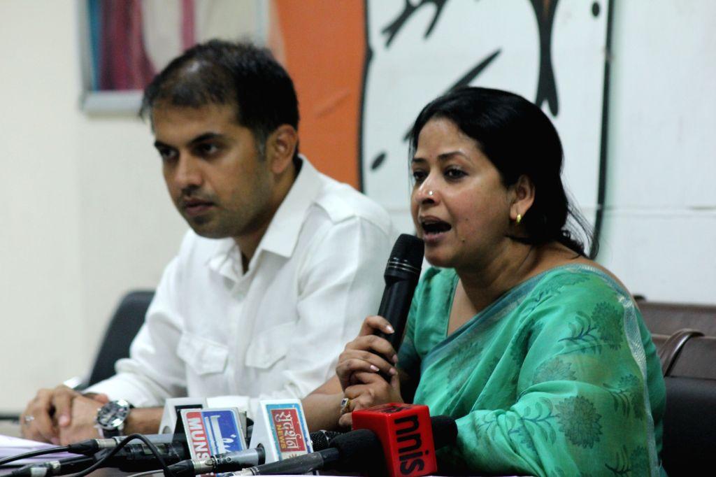 Congress leader Sharmistha Mukherjee addresses a press conference in New Delhi, on Aug 17, 2015. - Sharmistha Mukherjee