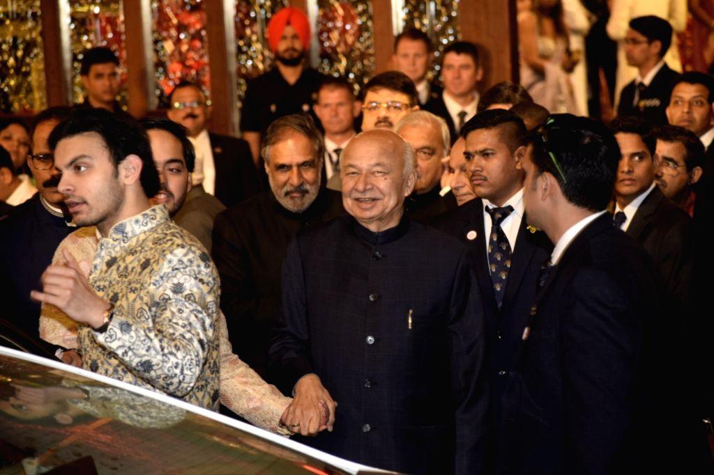 Congress leader Sushilkumar Shinde at the wedding ceremony of industrialist Mukesh Ambani's daughter Isha Ambani and Anand Piramal at Antilia in Mumbai on Dec 12, 2018. - Mukesh Ambani and Isha Ambani