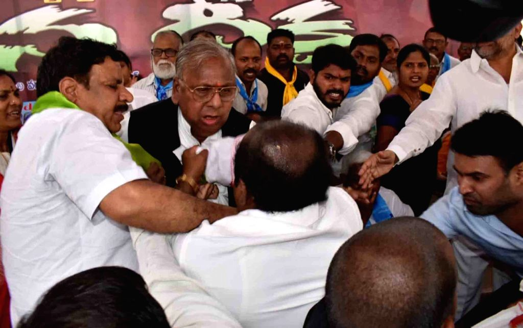 Congress leader V. Hanumantha Rao clashed with Telangana Pradesh Congress Committee (TPCC) spokesman M. Nagesh as they fight over a chair during a meeting organised by the opposition ... - V. Hanumantha Rao