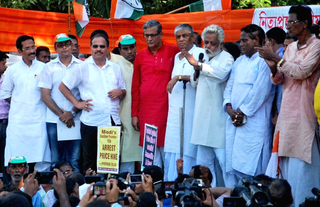 Congress leaders Adhir Choudhury, Abdul Mannan, CPI-M leader Tanmay Bhattacharya and others during a protest rally against the price hike of commodities in Kolkata, on June 25, 2016. - Adhir Choudhury