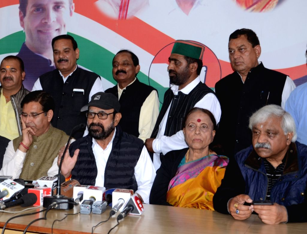 Congress leaders Anugrah Narayan Singh (2nd L), Pritam Singh (L) and Indira Hridayesh (2R) during a press conference in Dehradun on March 17, 2019. - Anugrah Narayan Singh and Pritam Singh