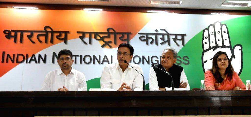 Congress leaders Ashok Gehlot and Randeep Singh Surjewala during the release of  party's posters for 'Vishwashghaat' (India Betrayed) Campaign - which highlights the failures of four years ... - Randeep Singh Surjewala