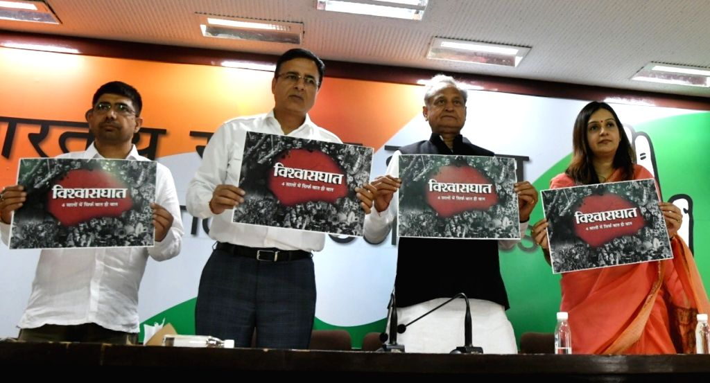 Congress leaders Ashok Gehlot and Randeep Singh Surjewala release the party's protest posters for 'Vishwashghaat' (India Betrayed) Campaign - which highlights the failures of four years of ... - Randeep Singh Surjewala