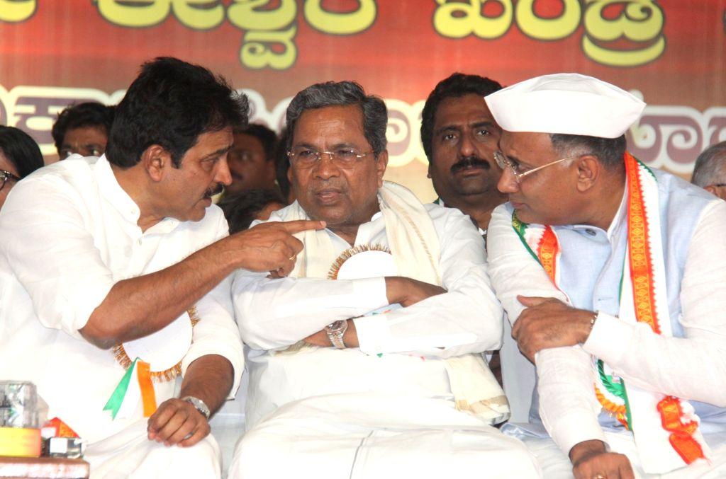 Congress leaders D. K. Shivakumar, K. C. Venugopal, G. Parameshwara, Siddaramaiah, Dinesh Gundu Rao and Eshwara Khandre at a party programme where Dinesh Gundu Rao and Eshwara Khandre took ... - Dinesh Gundu Rao
