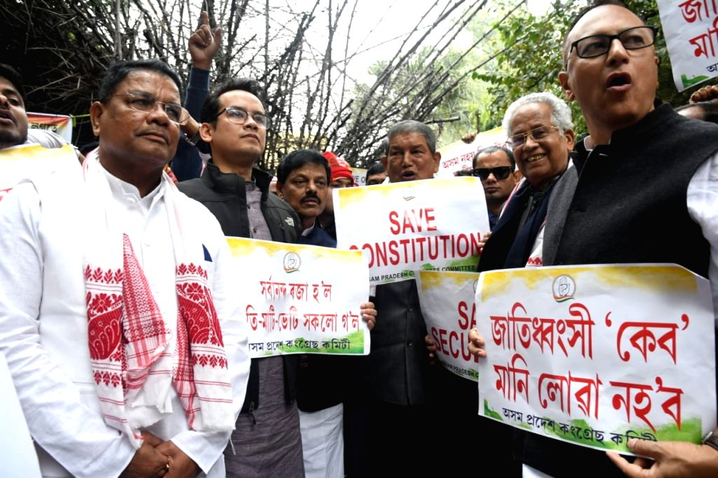 Congress leaders - Former Assam Chief Minister Tarun Gogoi, Assam Congress President Ripun Bora, party MP Gaurav Gogoi, Former Uttaarakhand Chief Minister Harish Rawat stage a ... - Tarun Gogoi