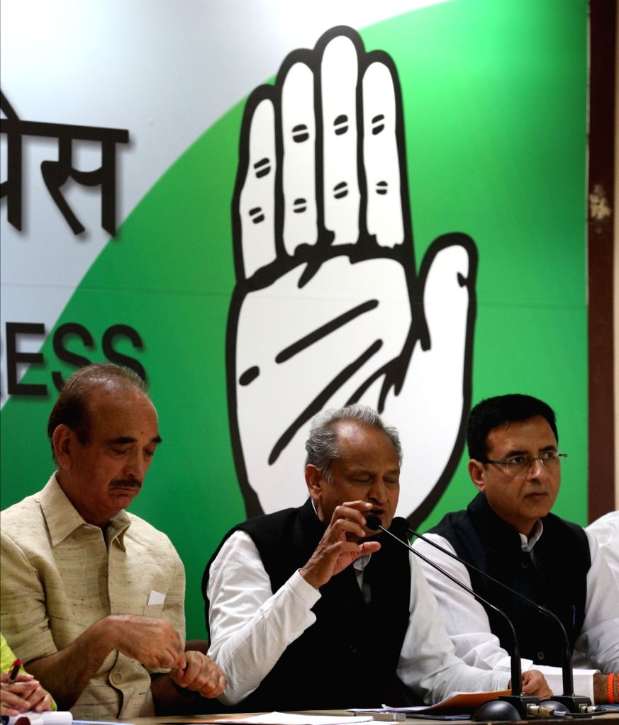Congress leaders Ghulam Nabi Azad, Ashok Gehlot and Randeep Surjewala during a press conference, in New Delhi on May 26, 2018.