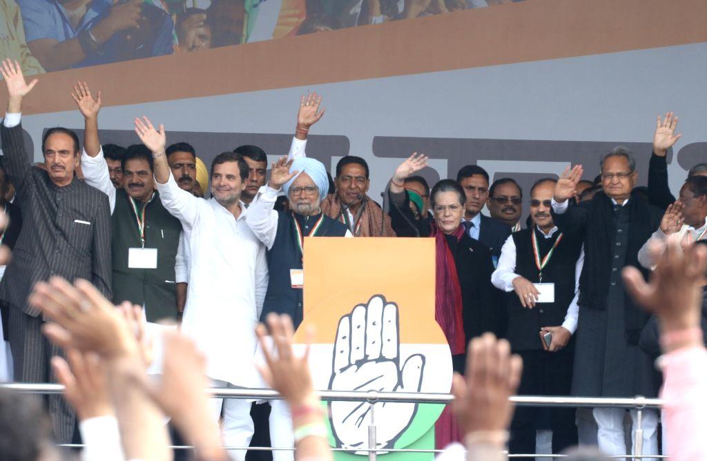 Congress leaders Ghulam Nabi Azad, KC Venugopal, Rahul Gandhi, Manmohan Singh, Sonia Gandhi, R. C. Khuntia, Adhir Ranjan Chowdhury and Rajasthan Chief Minister Ashok Gehlot wave at party ... - Ashok Gehlot, Rahul Gandhi, Manmohan Singh and Sonia Gandhi