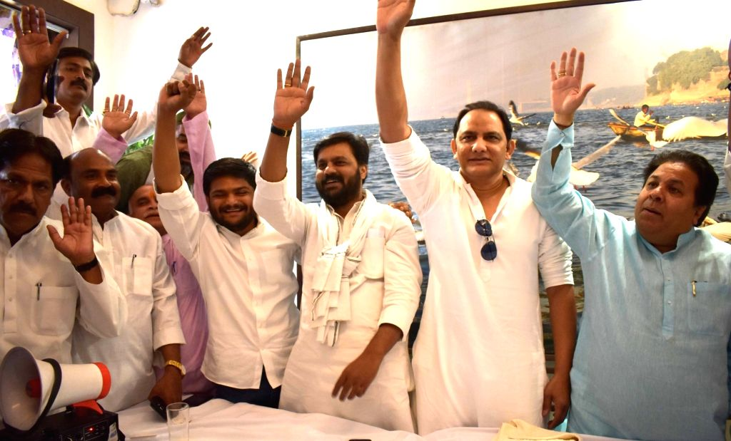 Congress leaders Hardik Patel, Mohammad Azharuddin and Rajeev Shukla during an election campaign for the forthcoming Lok Sabha polls, in Prayagraj on May 10, 2019. - Hardik Patel and Azharuddin