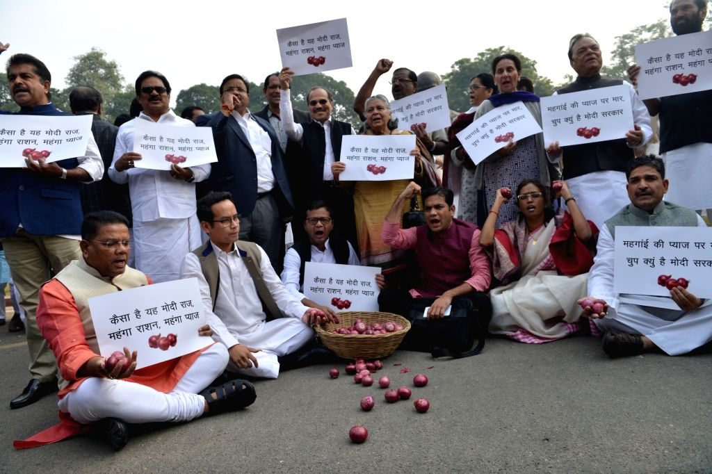Congress leaders, including P Chidambaram protest over onion prices at Parliament House in New Delhi on Dec. 5, 2019. (Photo; IANS)