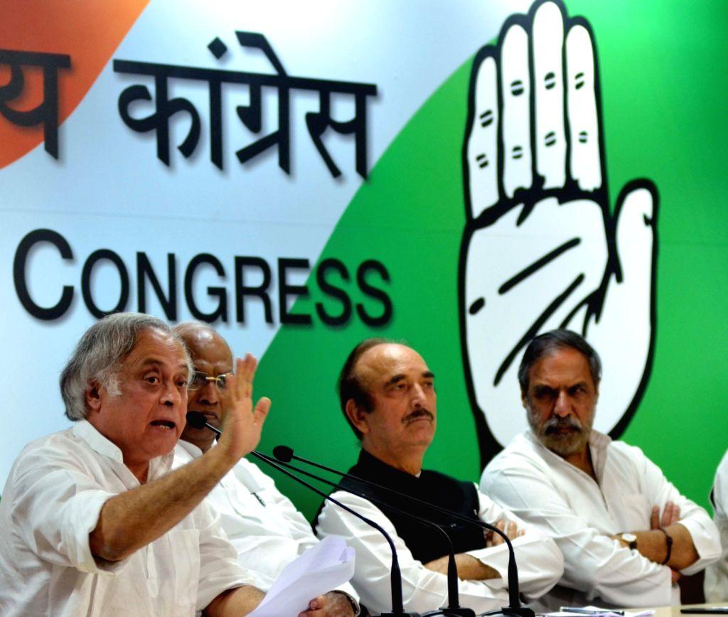 Congress leaders Jairam Ramesh, Mallikarjun Kharge, Ghulam Nabi Azad and Anand Sharma during a press conference regarding GST; in New Delhi on June 29, 2017. - Anand Sharma