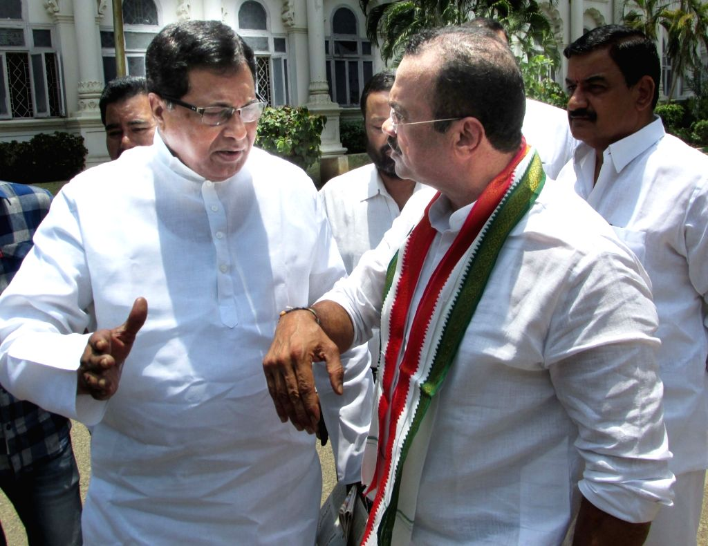 Congress leaders K. Jana Reddy and Komatireddy Venkat Reddy outside the High Court after the court dismissed a review petition of the ruling Telangana Rashtra Samithi seeking expulsion of ... - K. Jana Reddy and Komatireddy Venkat Reddy