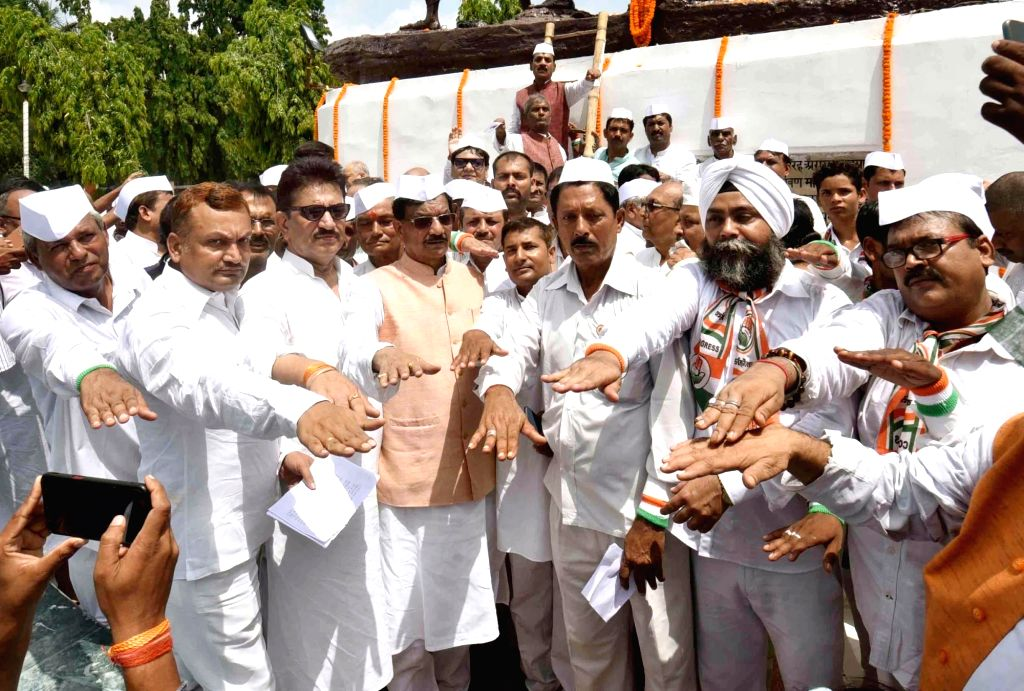 Congress leaders led by Bihar party President Madan Mohan Jha take pledge as they observe the 77th anniversary of Quit India movement, also known as August Kranti Diwas, at Shaheed Smarak in ...