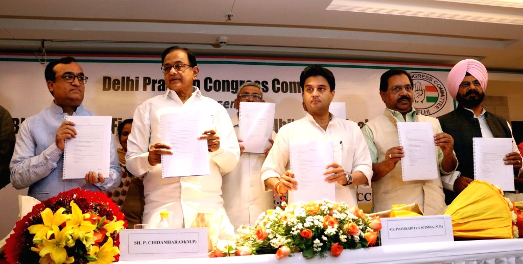 "Congress leaders P Chidambaram, Ajay Maken, Jyotiraditya Scindia and others during a programme organised to release ""Draft Blue Print for Fiscally Self-Reliant Municipal ..."