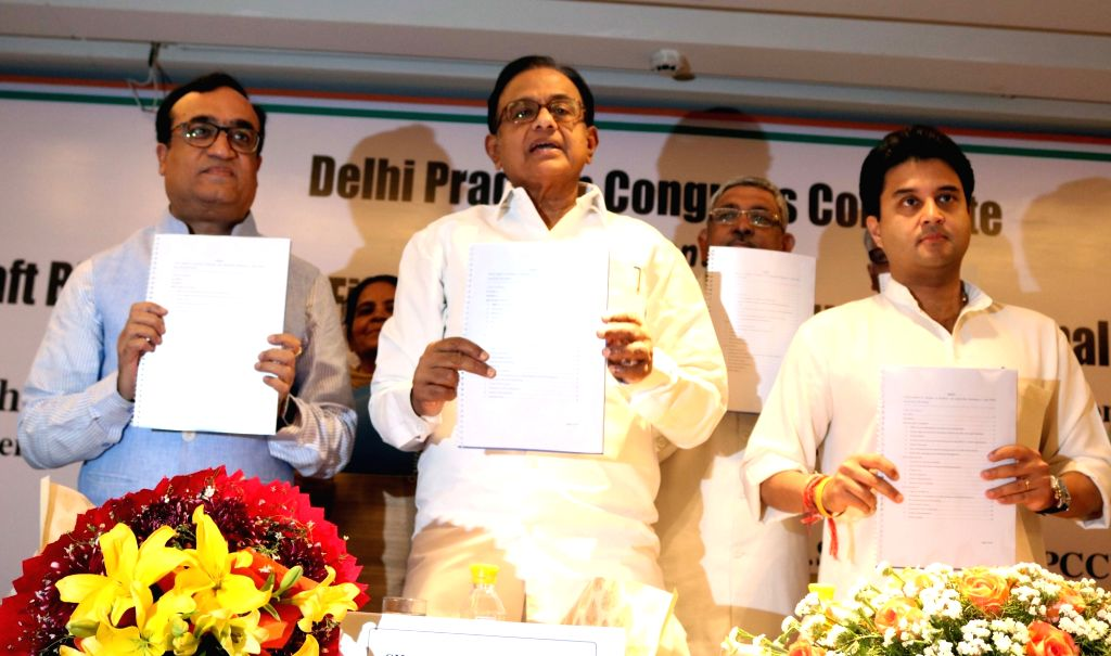 "Congress leaders P Chidambaram, Ajay Maken and Jyotiraditya Scindia during a programme organised to release ""Draft Blue Print for Fiscally Self-Reliant Municipal Corporations"" in ..."