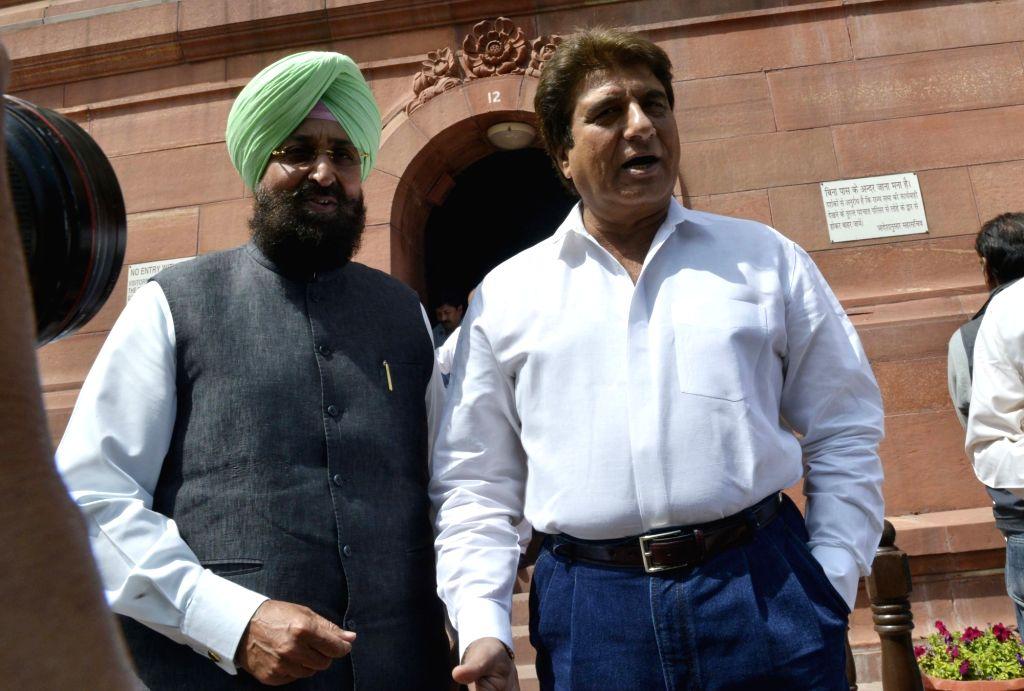 Congress leaders Partap Singh Bajwa and Raj Babbar at Parliament in New Delhi on Feb 15, 2017. - Partap Singh Bajwa