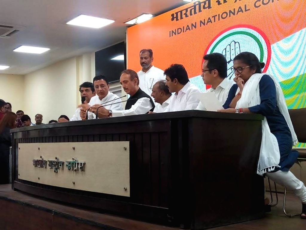 Congress leaders R.P.N. Singh, Randeep Singh Surjewala, Ghulam Nabi Azad, A.K. Antony, K. C. Venugopal, Gaurav Gogoi and Sushmita Dev during a press conference at the party's headquarters ... - N. Singh, Randeep Singh Surjewala and Sushmita Dev