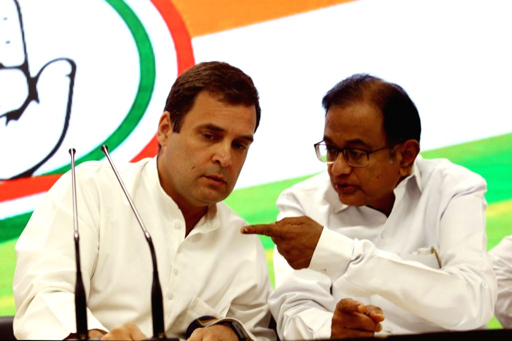 Congress leaders Rahul Gandhi and P. Chidambaram during a press conference at the party's headquarter, in New Delhi on May 4, 2019. - Rahul Gandhi