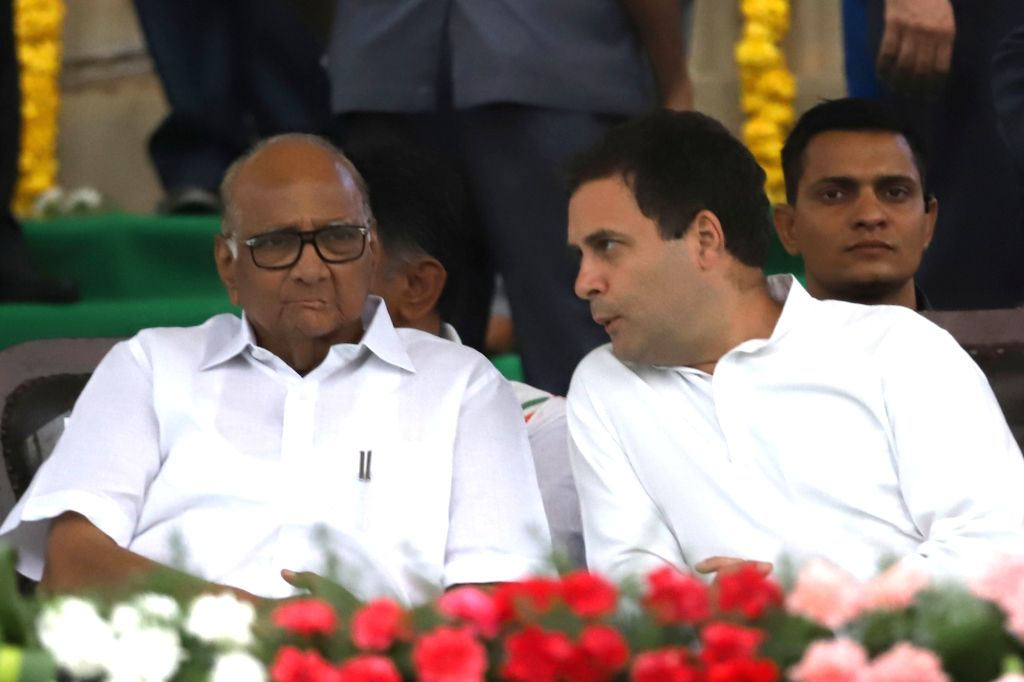 Congress leaders Rahul Gandhi and Sharad Pawar during the swearing-in ceremony of Karnataka Chief Minister H.D. Kumaraswamy, at Vidhana Soudha in Bengaluru on May 23, 2018. - H. and Rahul Gandhi