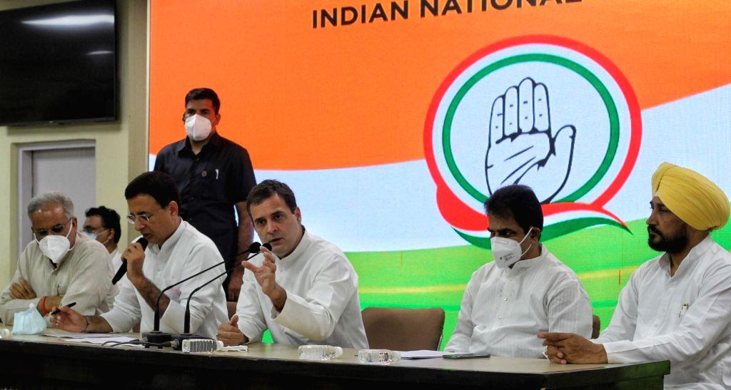 Congress leaders Rahul Gandhi, Chhattisgarh Chief Minister Bhupesh Baghel, Punjab Chief Minister Charanjit Singh Channi, chief spokesman Randeep Surjewala, and K.C. Venugopal addressing a ... - Bhupesh Baghel, Rahul Gandhi and Charanjit Singh Channi