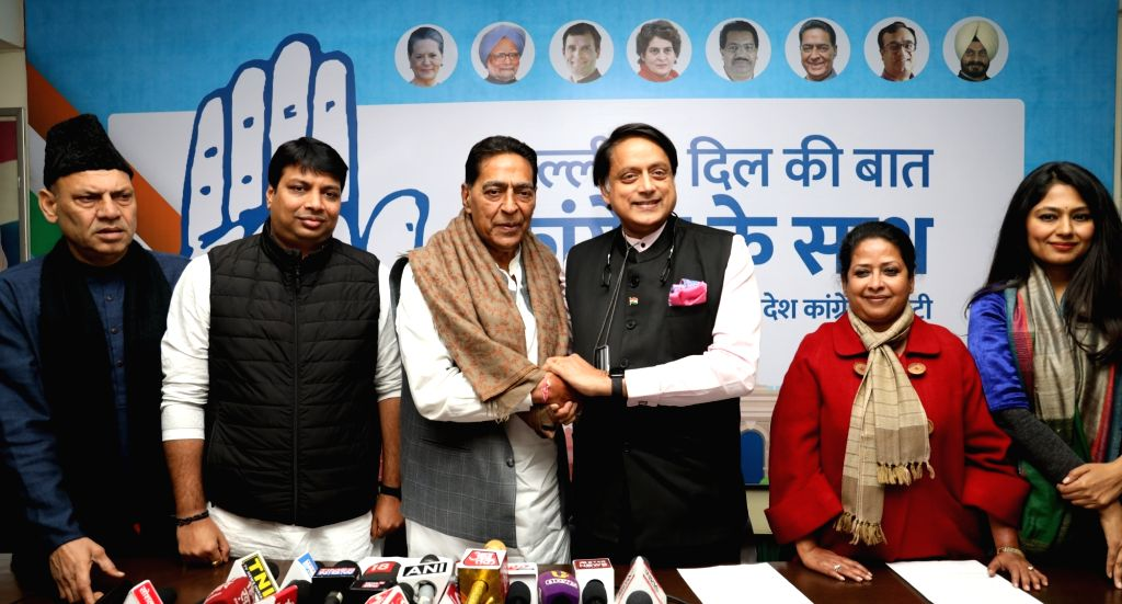 Congress leaders Shashi Tharoor and Subhash Chopra at the launch of a campaign to crowd source ideas and suggestions from the people of Delhi to be incorporated in the Congress manifesto ... - Shashi Tharoor and Subhash Chopra