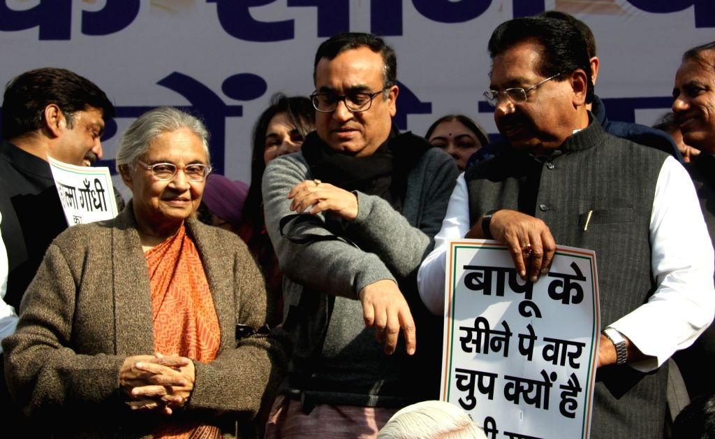 Congress leaders Sheila Dikshit and Ajay Maken during a demonstration against the insult meted out to Mahatma Gandhi by activists of the Akhil Bharat Hindu Mahasabha (ABHM), in New Delhi  ... - Sheila Dikshit and Nathuram Godse