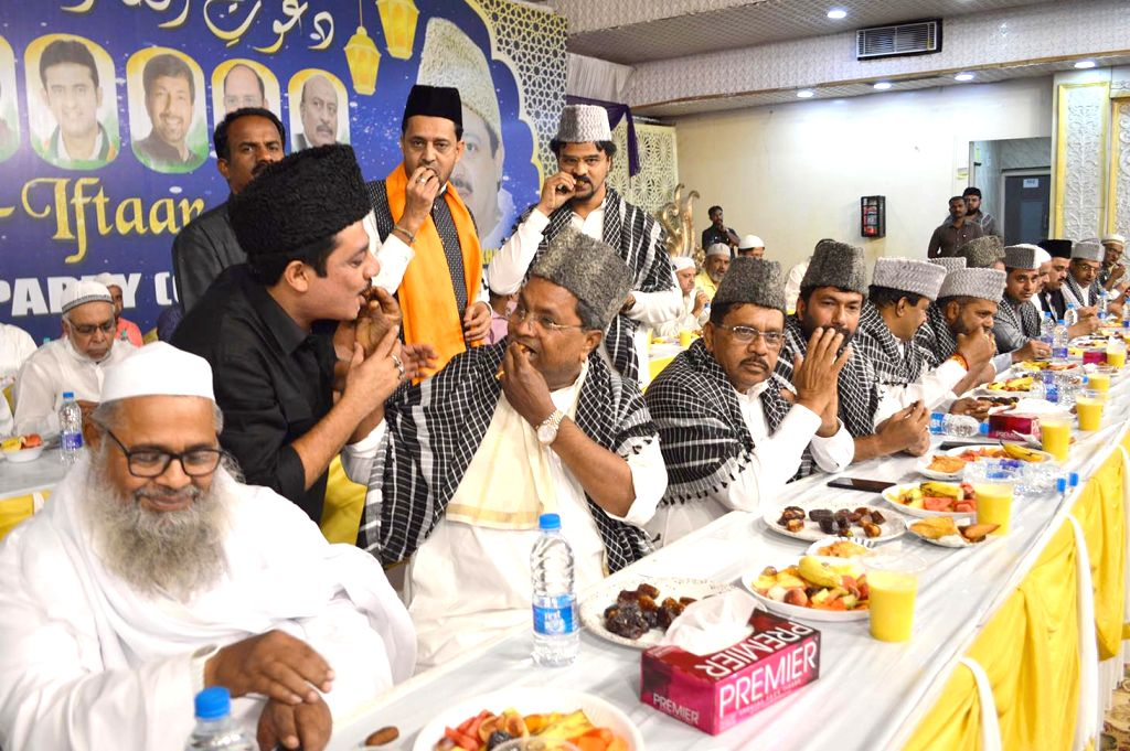 Congress leaders Siddaramaiah and Dr G Parameshwar during an iftaar party hosted by Zameer Ahmed Khan in Bengaluru, on June 3, 2019. - Zameer Ahmed Khan