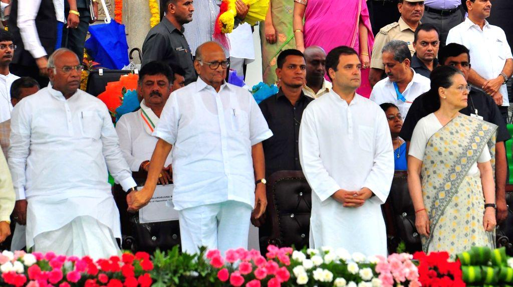 Congress leaders Sonia Gandhi, Rahul Gandhi, Mallikarjun Kharge and NCP chief Sharad Pawar  at the swearing in ceremony of Karnataka Chief Minister H.D.Kumaraswamy in Bengaluru on May 23, ... - H., Sonia Gandhi and Rahul Gandhi