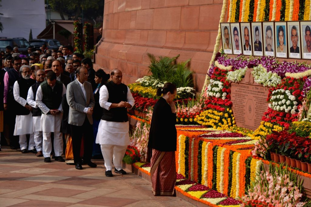 Congress leaders Sonia Gandhi with other senior political leaders pay tribute during the anniversary of 2001 Parliament Attack at Parliament House in New Delhi on Dec. 13, 2018. - Sonia Gandhi