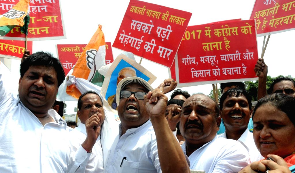 Congress leaders stage a demonstration against Modi government, in Amritsar, on June 27, 2016.